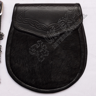Black Cow Skin and celtic embossed on flap