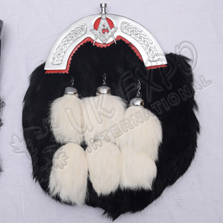 Black rabbit furr with Six Tessels red backing on cantle Masonic Badge