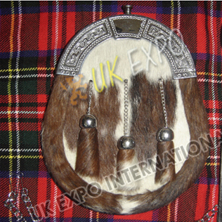 Brown and white cow hide skin with sinple celtic cantle